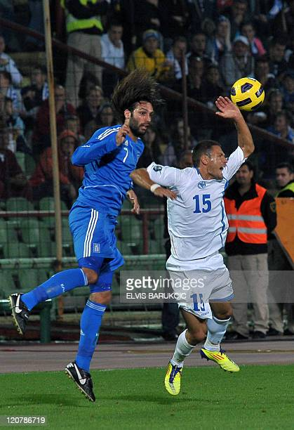 Bosnia's Sejad Salihovic vies for ball with Greece's Georgios Samaras during a friendly match between the two national teams in Sarajevo on August 10...