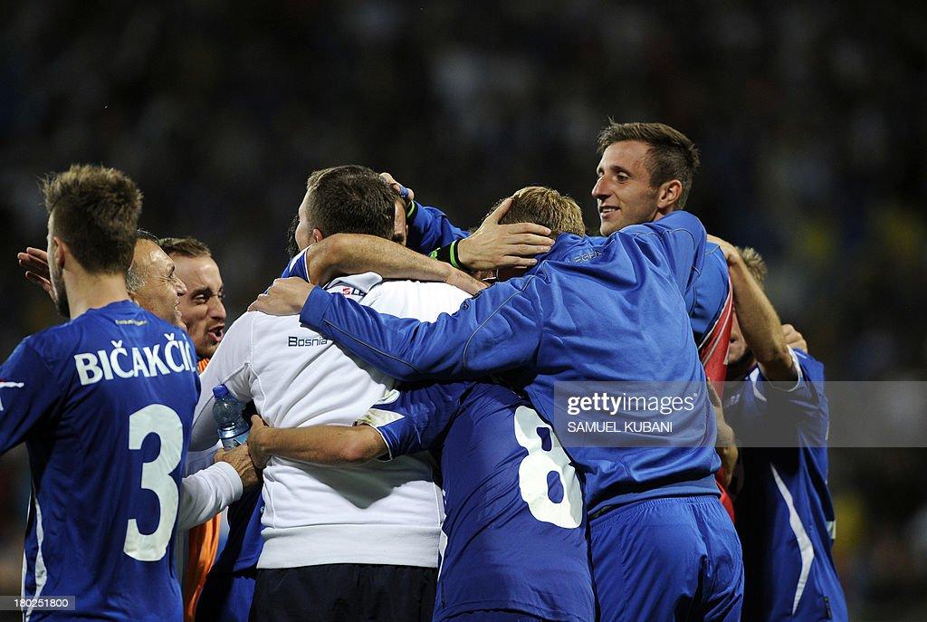 Bosnia's team celebrates after the FIFA World Cup 2014 qualifying football match Slovakia vs Bosnia-Herzegovina in Zilna on September 10, 2013. AFP PHOTO / SAMUEL KUBANI