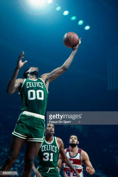 Boson Celtics' Robert Parish jumps for a layup against the Washington Bullets at Capital Center circa early 1980's in Washington DC NOTE TO USER User...