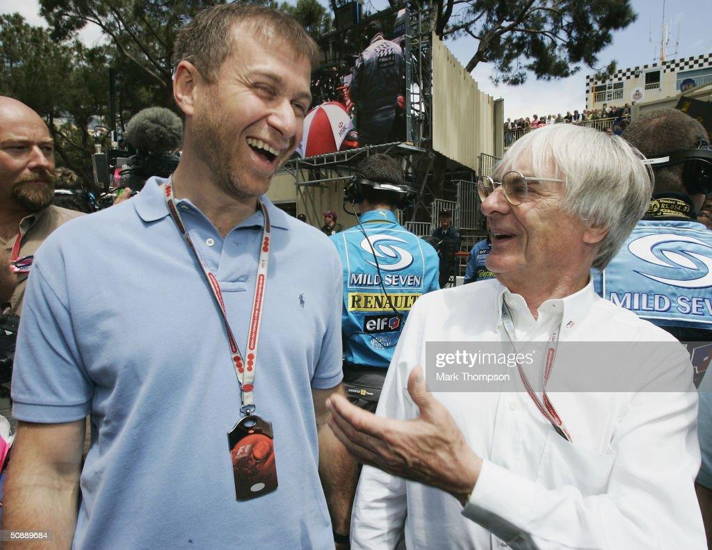 F1 boss Bernie Ecclestone (R) shares a joke with Chelsea FC owner Roman Abramovich on the grid prior to the Monaco F1 Grand Prix on May 23, 2004, in Monte Carlo, Monaco.
