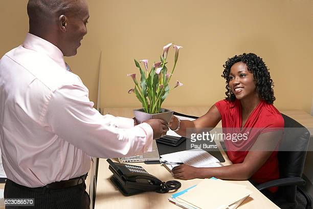 Boss giving his administrative assistant flowers