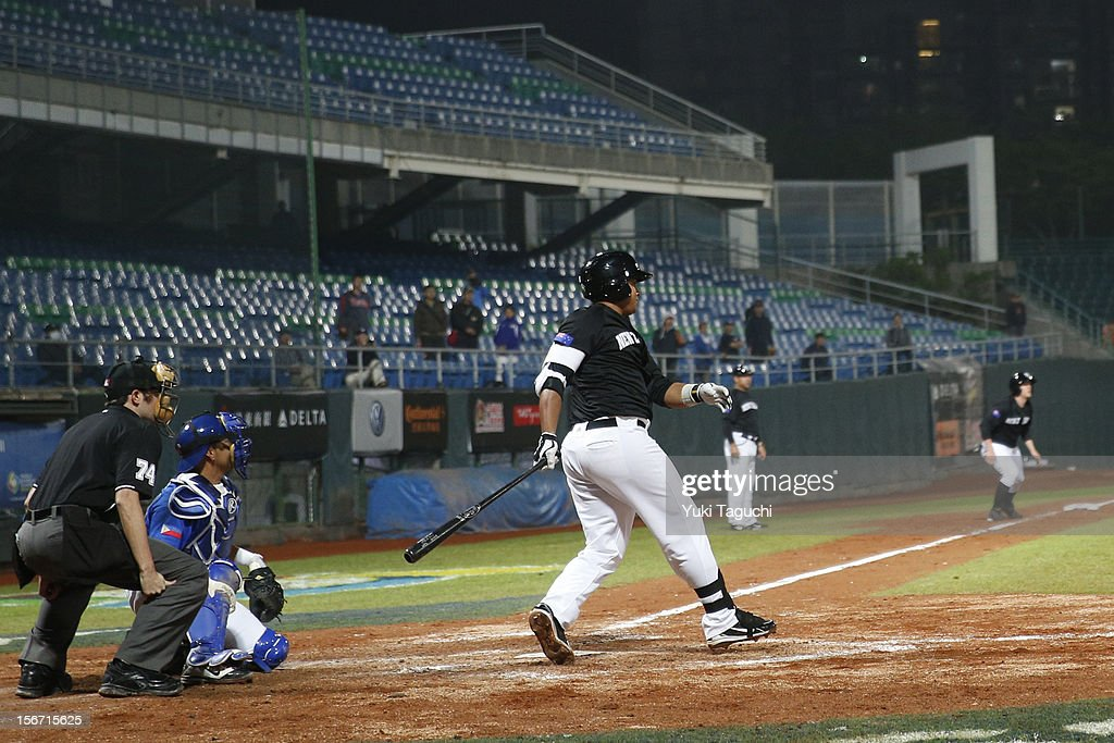 Boss Moanaroa #8 of Team New Zealand hits a two run RBI single in the top of the fifth inning during Game 5 of the 2013 World Baseball Classic Qualifier against Team Philippines at Xinzhuang Stadium in New Taipei City, Taiwan on Saturday, November 17, 2012.