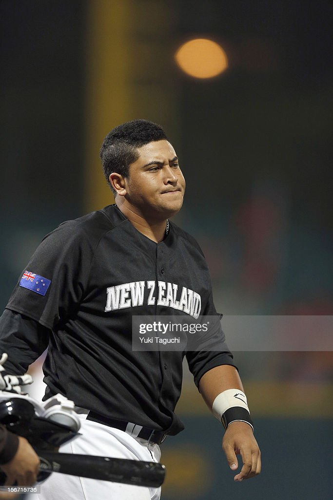 Boss Moanaroa #8 of Team New Zealand walks back to the dugout after striking out to end the top of the first inning during Game 6 of the 2013 World Baseball Classic Qualifier against Team Chinese Taipei at Xinzhuang Stadium in New Taipei City, Taiwan on Sunday, November 18, 2012.