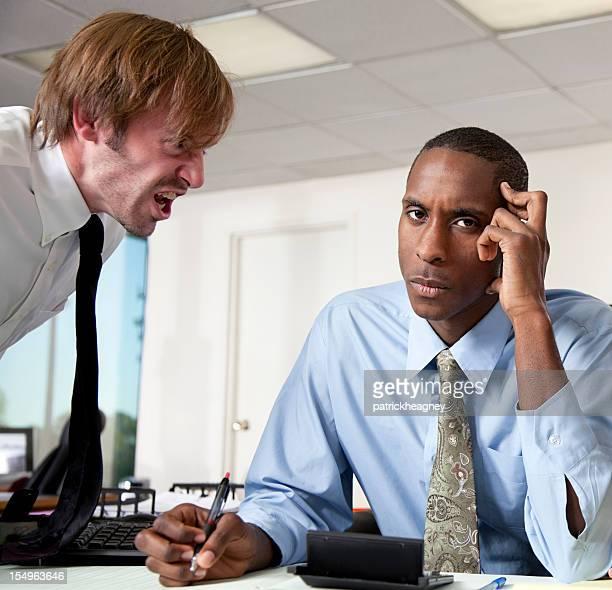 Boss scolding an employee