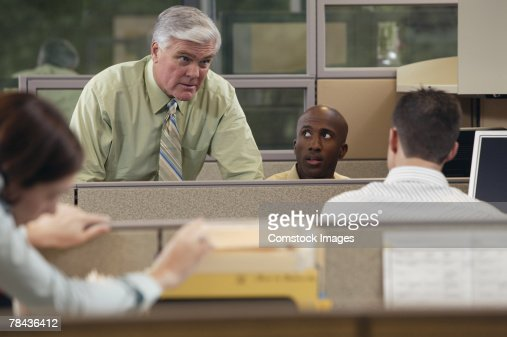 Boss talking to employees