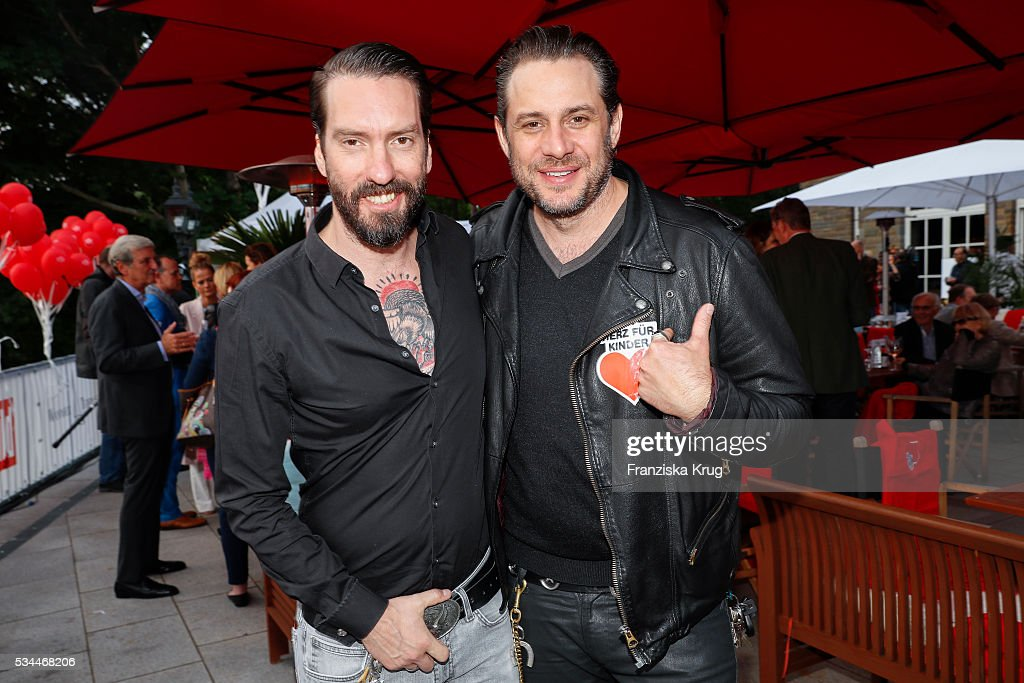 BossHoss band member Alec Voelkel and Sascha Vollmer during the 'Ein Herz fuer Kinder' summer party at Wannseeterrassen on May 26, 2016 in Berlin, Germany.