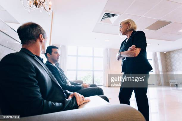 Bossy woman scolding coworkers