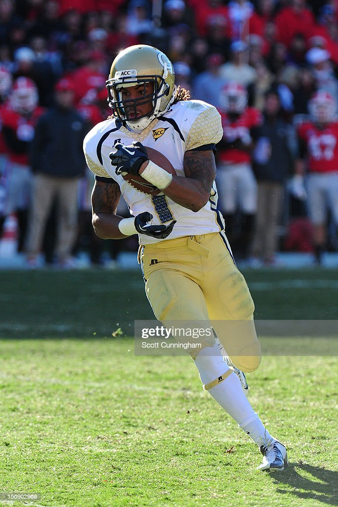 B. J. Bostic #7 of the Georgia Tech Yellow Jackets runs with a catch against the Georgia Bulldogs at Sanford Stadium on November 24, 2012 in Athens, Georgia.