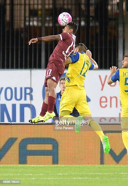 Bostjan Cesar of Chievo Verona battles for an aerial ball with Josef Martinez of Torino FC during the Serie A match between AC Chievo Verona and...