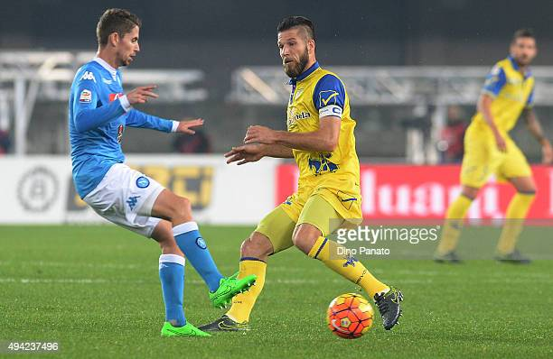 Bostjan Cesar of Chievo Verona competes with Jorginho of SSC Napoli during the Serie A match between AC Chievo Verona and SSC Napoli at Stadio...