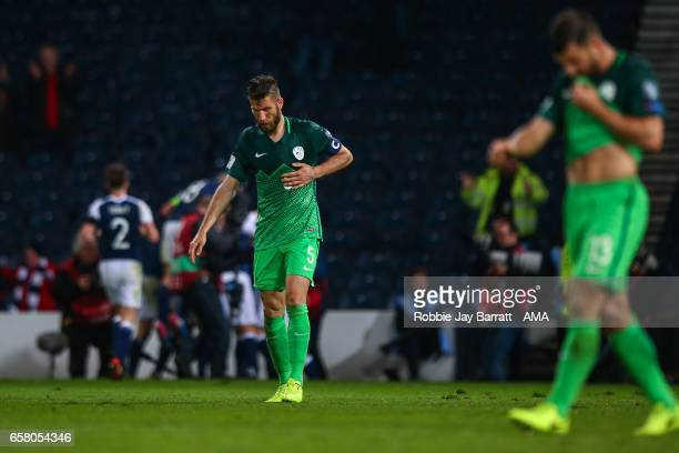 Bostjan Cesar of Slovenia looks dejected after his team conceded a goal to make it 10 during the FIFA 2018 World Cup Qualifier between Scotland and...