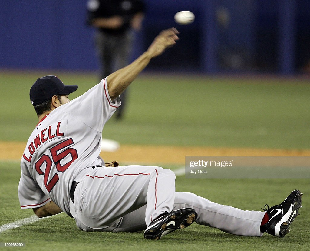 Boston 3B Mike Lowell made a diving stop and threw from a prone position to just nail Toronto's Aaron Hill at 1st base in MLB action at Rogers Centre...