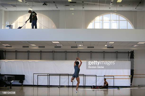 Boston Ballet's two new principal dancers married couple Petra Conti and Eris Nezha rehearse with Assistant Artistic Director Russell Kaiser at the...