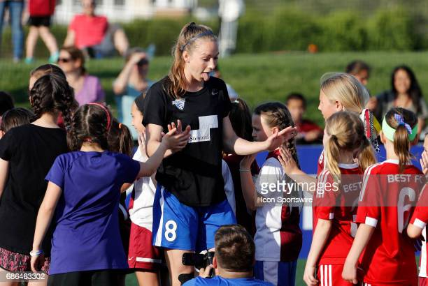 Boston Breakers defender Julie King greets fans on her way to warm up before an NWSL regular season match between the Boston Breakers and Portland...