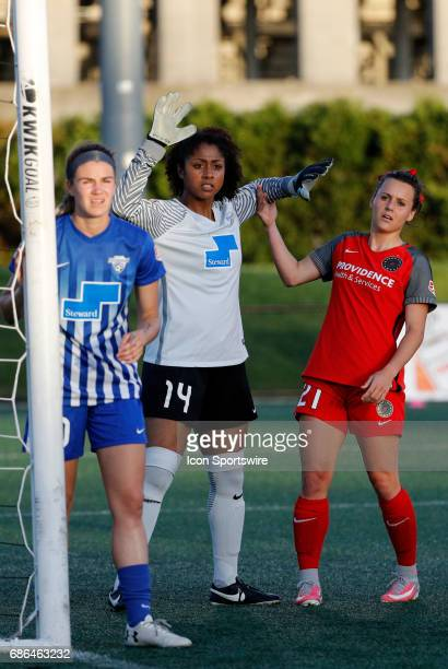 Boston Breakers goalkeeper Abby Smith and Portland Thorns FC forward Hayley Raso jostle as Boston Breakers defender Christen Westphal guards the post...