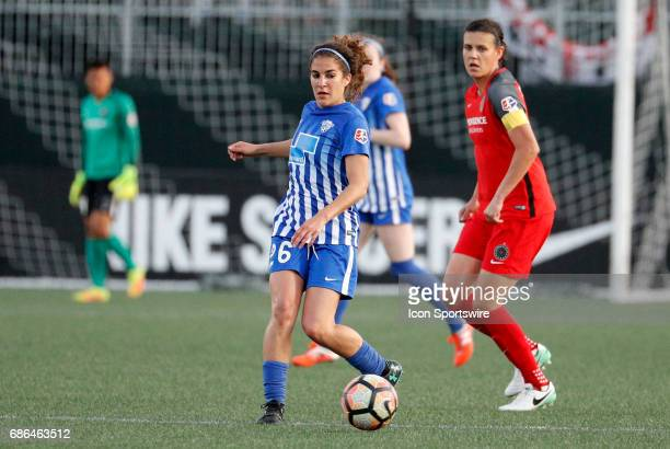Boston Breakers midfielder Angela Salem plays the ball away from Portland Thorns FC forward Christine Sinclair during an NWSL regular season match...