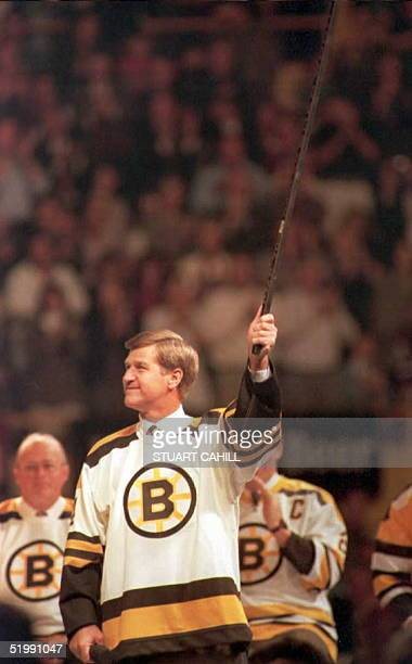 Boston Bruin great Bobby Orr raises his stick in tribute during closing ceremonies of the Boston Garden 29 September The Garden is being replaced...