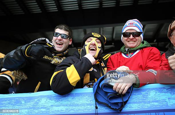 Boston Bruins and Montreal Canadiens fans pose prior to the stadium prior to the 2016 Bridgestone NHL Winter Classic at Gillette Stadium on January 1...