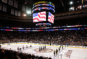 Boston Bruins and the Philadelphia Flyers stand during the National Anthem before their NHL season opener on October 8 2014 in Boston Massachusetts 2