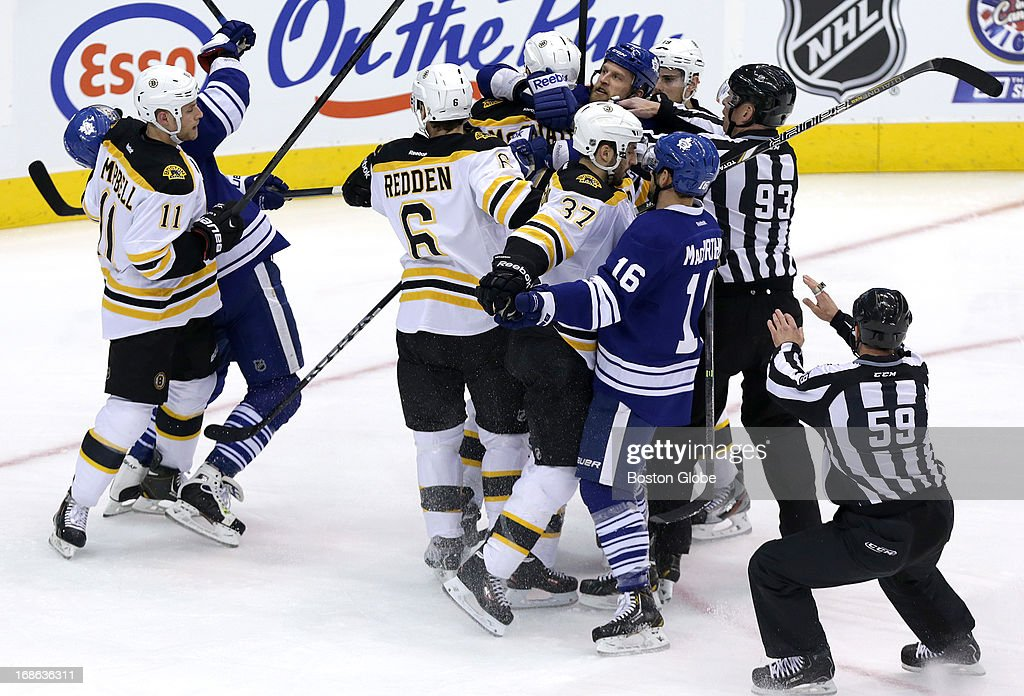 Boston Bruins and the Toronto Maple Leafs mix it up during a first period scrum. The Boston Bruins take on the Toronto Maple Leafs in Game Six of the Eastern Conference Quarterfinals of the Stanley Cup Playoffs at the Air Canada Centre in Toronto.