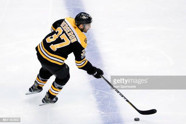Boston Bruins center Patrice Bergeron gains the blue line during a game between the Boston Bruins and the Vancouver Canucks on October 19 at TD...
