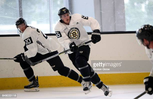 Boston Bruins center Riley Nash and Boston Bruins center Noel Acciari are pictured during the first day of training camp at Warrior Ice Arena in the...