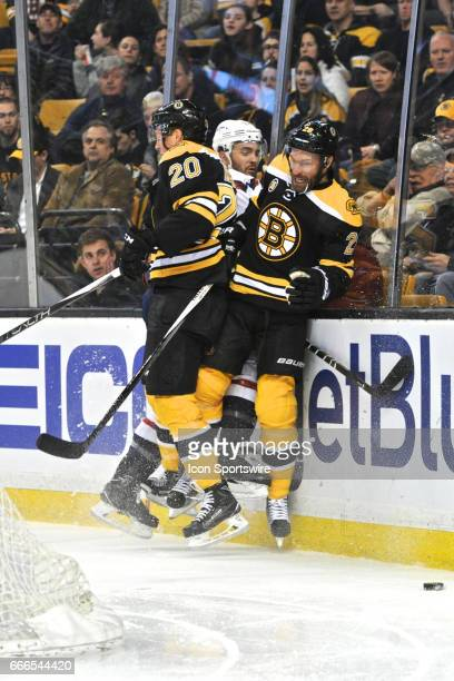Boston Bruins Center Riley Nash and Boston Bruins Left Wing Dominic Moore sandwich Washington Capitals Defenceman Kevin Shattenkirk up against the...
