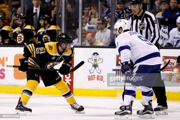 Boston Bruins center Ryan Spooner moves in for a face off with Tampa Bay Lightning center Tyler Johnson during a regular season NHL game between the...