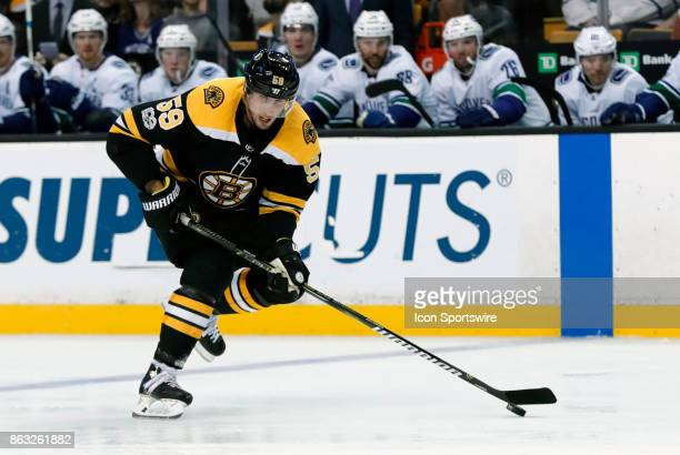 Boston Bruins center Tim Schaller gains the blue line during a game between the Boston Bruins and the Vancouver Canucks on October 19 at TD Garden in...