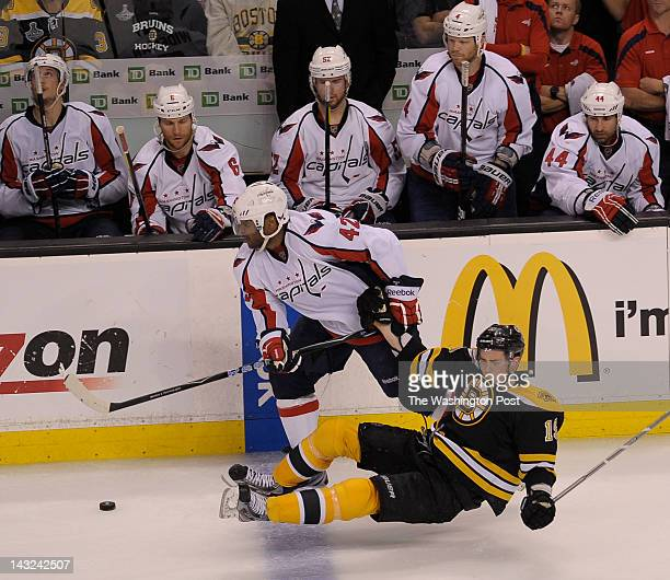 Boston Bruins center Tyler Seguin is knocked to the ice while pursuing the puck by Washington Capitals right wing Joel Ward during the third period...