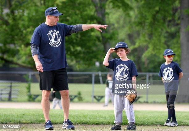 Boston Bruins coach Bruce Cassidy gestures during a game between the Mighty Molars youth baseball team and the Tax Warriors in Providence RI on May...