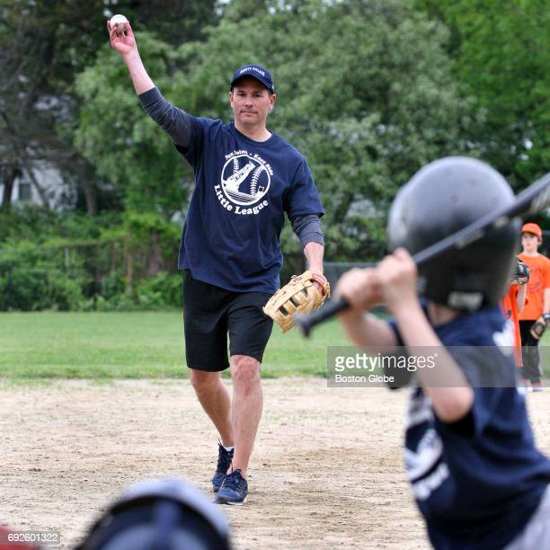 Boston Bruins coach Bruce Cassidy pitches against his son Cole during a Mighty Molars youth baseball team game in Providence RI on May 23 2017 The...