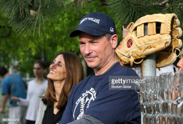 Boston Bruins coach Bruce Cassidy watches the action as the Mighty Molars youth baseball team plays in Providence RI on May 23 2017 His wife Julie is...