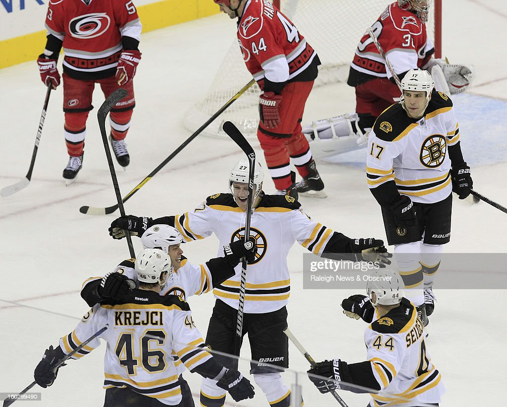 Boston Bruins' congratulate David Krejci (46) after he scored the go-ahead goal during the third period against the Carolina Hurricanes at PNC Arena in Raleigh, North Carolina, Monday, January 28, 2013. The Bruins beat the Hurricanes 5-3.