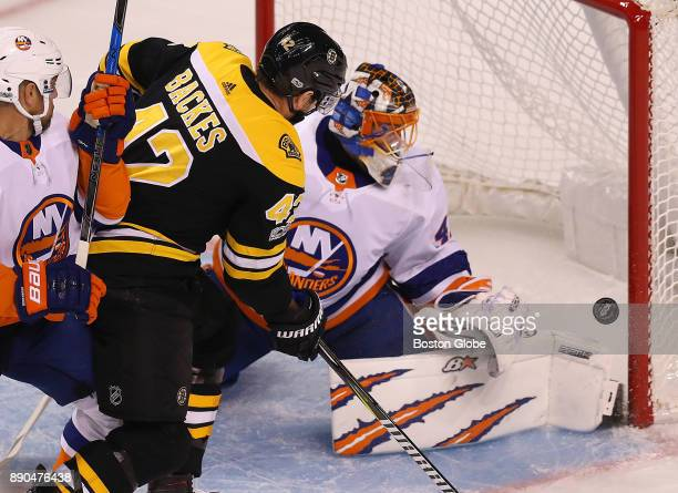 Boston Bruins' David Backes gets a close shot off in the first period but Islanders goalie Jaroslav Halak denies him with a pad save The Boston...