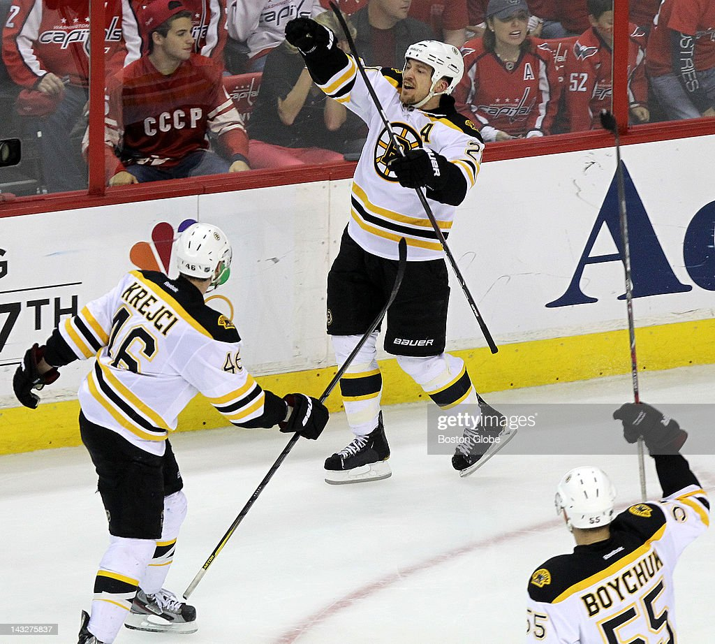 Boston Bruins defenseman Andrew Ference (#21) celebrates after briefly putting the Bruins up 3-2 during the third period. The Boston Bruins took on the Washington Capitals in game six of the Stanley Cup Eastern Conference Quarter-Finals at Washington's Verizon Center.