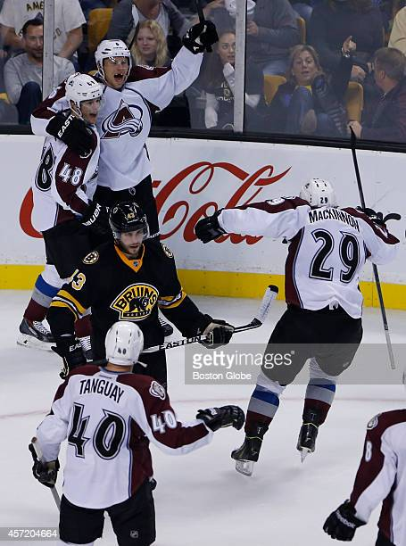 Boston Bruins defenseman Matt Bartkowski center skates away as Colorado Avalanche center Daniel Briere celebrates his game winning goal against the...