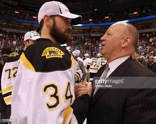 Boston Bruins defenseman Shane Hnidy and Boston Bruins head coach Claude Julien The Boston Bruins took on the Vancouver Canucks in Game 7 of the NHL...