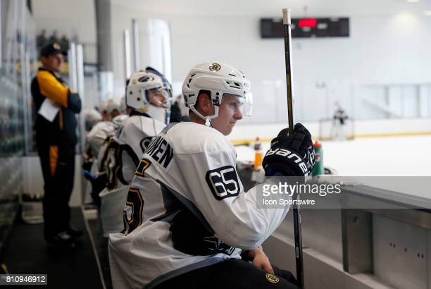 Boston Bruins defenseman Urho Vaakanainen waits for his shift on the bench during Bruins Development Camp on July 8 2017 at Warrior Ice Arena in...