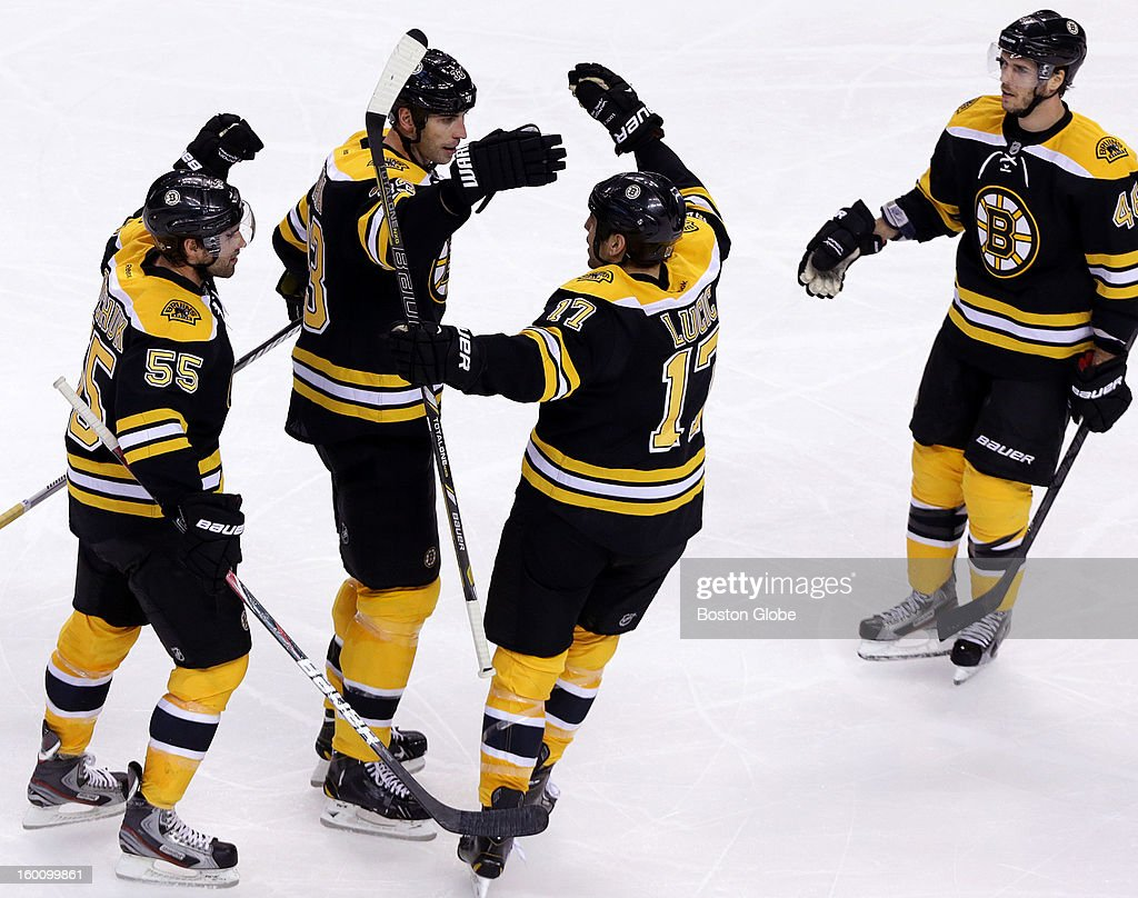 Boston Bruins defenseman Zdeno Chara (#33) celebrates after his shot from the point scored the eventual game winning goal during the third period as the Boston Bruins play the New York Islanders in an NHL regular season game at TD Garden.