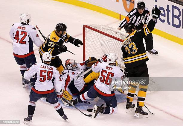 Boston Bruins defenseman Zdeno Chara celebrates his power play goal that beat Washington Capitals goalie Pheonix Copley for what turned out to be the...