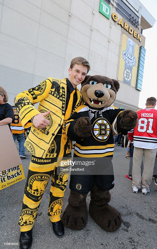 A Boston Bruins fan wearing a suit of rally towels poses with Bruins mascot Blades before Game Four of the 2013 Stanley Cup Final between the Chicago Blackhawks and the Boston Bruins at TD Garden on June 19, 2013 in Boston, Massachusetts.