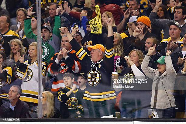 Boston Bruins fans celebrate after Loui Eriksson of the Boston Bruins scored a goal against the Detroit Red Wings during the third period at TD...