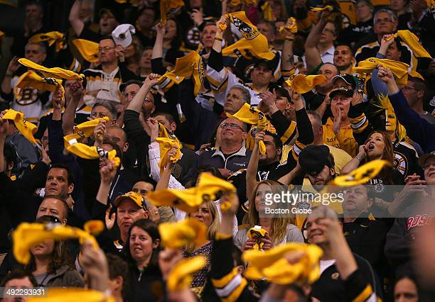 Boston Bruins fans cheered at the start of the game during the Boston Bruins vs Montreal Canadiens game seven playoff