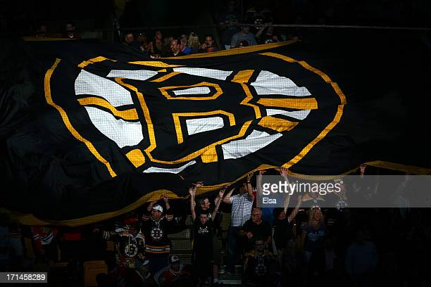 Boston Bruins fans hold a giant flag with the Boston Logo on it prior Game Six of the 2013 NHL Stanley Cup Final against the Chicago Blackhawks at TD...