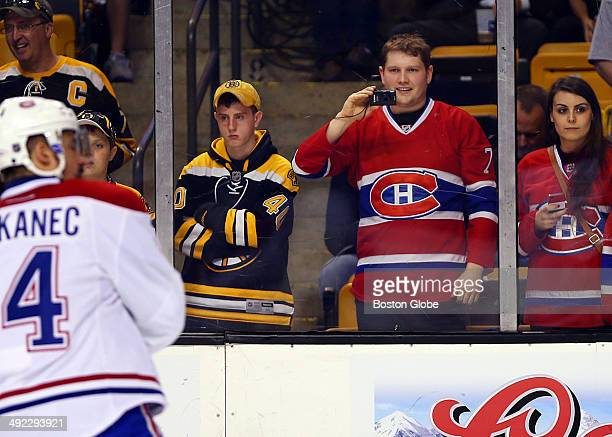 Boston Bruins fans stand next to Montreal Canadiens fans during pregame warmups for the the Boston Bruins vs Montreal Canadiens game seven playoff