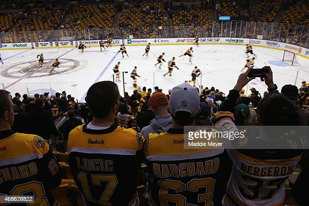 Boston Bruins fans watch their team warmup before the game against the Toronto Maple Leafs at TD Garden on April 4 2015 in Boston Massachusetts