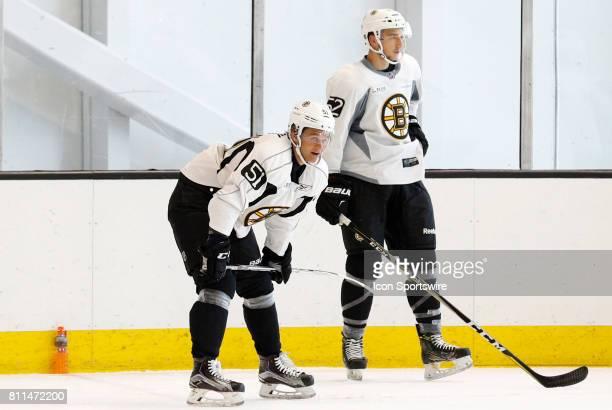 Boston Bruins forward Anders Bjork gets ready for the timed drill as Boston Bruins forward Cedric Pare waits his turn during Bruins Development Camp...