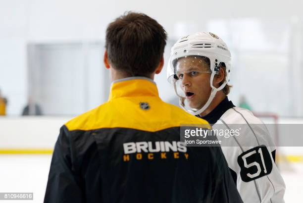 Boston Bruins forward Anders Bjork talks with a coach during Bruins Development Camp on July 8 2017 at Warrior Ice Arena in Boston Massachusetts