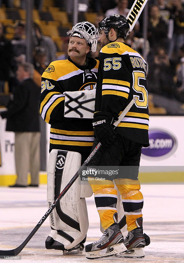 Boston Bruins goalie Tim Thomas (#30) and Boston Bruins defenseman Johnny Boychuk (#55) share a moment as they prepare to leave the ice following the Bruins loss in overtime to the Washington Capitals. Boston Bruins took on the Washington Capitals in game seven of the Stanley Cup Eastern Conference quarterfinals at TD Garden.